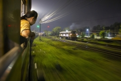 Passing through a midsize town on the night train between Chiang Mai and Bangkok