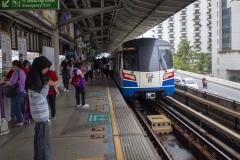 BTS train pulling into Saphan Taksin station, Silom, Bangkok, Thailand