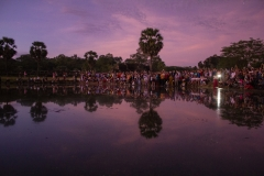 Crowds of people getting a good photo of the sunrise at Angkor Wat, Angkor complex, Cambodia